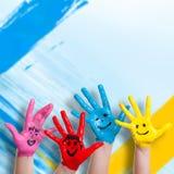 Mains peintes colorées Photographie stock libre de droits