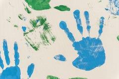 Mains peintes, embouti sur le papier Image stock