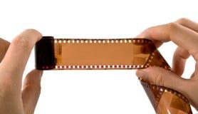 Mains photographiques de filmin Photos libres de droits