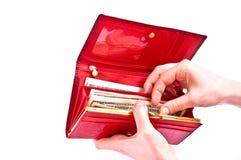 Mains, pochette et argent Images stock