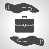 Mains protégeant l'icône de cas de portfolio Photos libres de droits