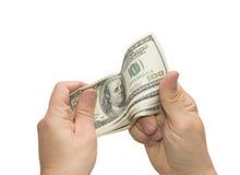 Mains qui retiennent les dollars Photographie stock libre de droits