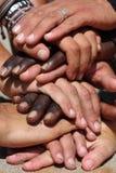 Mains raciales Photos libres de droits