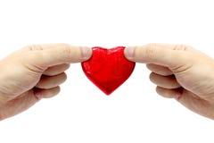 Mains retenant le coeur Photo libre de droits