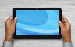 Mains retenant le touchpad images libres de droits