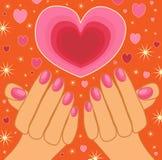 Mains retenant un coeur de pétillement Photos libres de droits