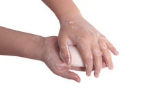 Mains savonneuses avec du savon Photo stock