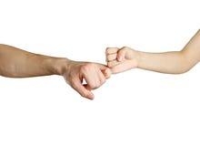 Mains se tenant par les auriculaires Amitié Image libre de droits