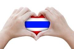 Mains sous forme de coeur avec des symboles du drapeau de la Thaïlande Photo stock