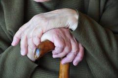 Mains sur la canne Photos libres de droits