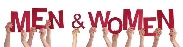 Mains tenant les hommes et les femmes rouges de Word Photo stock