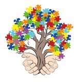 Mains tenant un arbre avec des puzzles autism Illustration de vecteur illustration stock