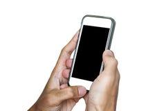 Mains utilisant le téléphone portable, d'isolement sur le fond blanc Photographie stock libre de droits