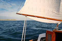 Mainsail of a classic sailing vessel, passing vlieland Stock Image