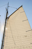 Mainsail and Wooden Mast of Schooner Sailboat Stock Images