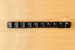 Mainstream word. With keyboard buttons Stock Photography