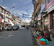Mainstreet of Leh town with sellers of vegetables Royalty Free Stock Photo