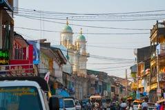 The mainstreet of Mawlamyine, Myanmar, with the beautiful mosque. . Burma. Royalty Free Stock Photos