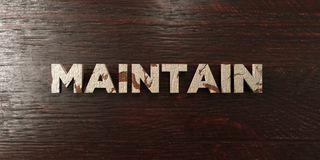 Maintain - grungy wooden headline on Maple  - 3D rendered royalty free stock image Royalty Free Stock Image
