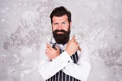 Maintain stylish shape. Barber tools. Taking good care facial hair. Bearded hipster shaving. Vintage barber. Barber in. Apron hairdresser equipment blade and stock photography