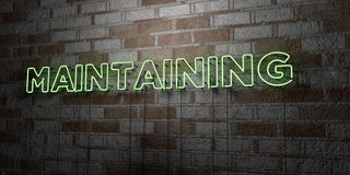MAINTAINING - Glowing Neon Sign on stonework wall - 3D rendered royalty free stock illustration. Can be used for online banner ads and direct mailers Royalty Free Stock Photos