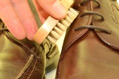 Maintaining leather shoes Stock Photo
