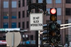 Maintaining order on crowded streets. Signs and traffic lights help control traffic flow on downtown intersections of Boston royalty free stock photography