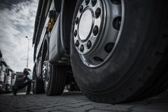 Maintaining Semi Truck Tires. Concept Photo. Trucking Industry Royalty Free Stock Image