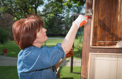 Maintaining of wooden surfaces Stock Photos