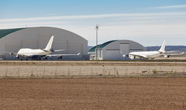 Maintenance aerodrome with planes and hangars. Airplane parking. Area. Industry stock image