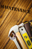 Maintenance  against desk with tools Stock Photography