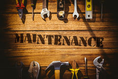 Maintenance  against desk with tools Royalty Free Stock Image