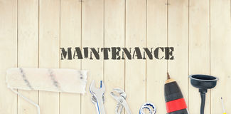 Maintenance  against diy tools on wooden background Royalty Free Stock Photos