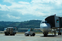 Maintenance of aircraft in the airport. Truck refueling an airplane on the airport stock photography