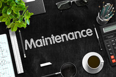 Maintenance on Black Chalkboard. 3D Rendering. Stock Photos