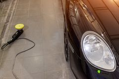 Maintenance of a black luxury car in operation after washing and stock images