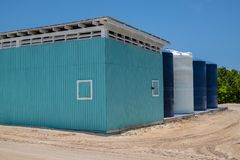 Maintenance Building Bahamas. A colorful maintenance building with water tanks on Princess Cays in the Bahamas royalty free stock photo