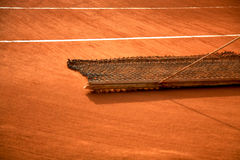 Maintenance of a clay tennis court. Picture of a clay tennis court drag mat at Roland Garros Royalty Free Stock Photo