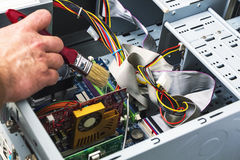 Maintenance and cleaning of the system unit of a personal comput. Er Royalty Free Stock Image