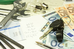 Maintenance costs of a car. Periodic maintenance costs related to cars Royalty Free Stock Photography