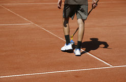 Maintenance of court. Young man cleaning lines of a court before competition Stock Image