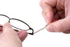 Maintenance des lunettes Photos libres de droits
