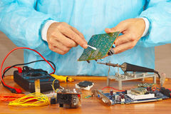 Maintenance of electronic devices in service workshop Stock Images