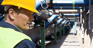 Maintenance engineer. At the waste water managemant system of a huge factory Stock Photos