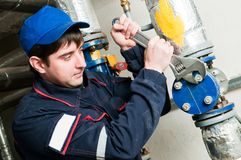 Maintenance engineer in boiler room Royalty Free Stock Images