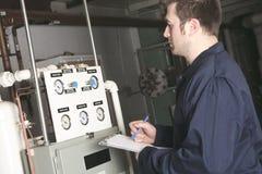 Maintenance engineer checking technical data of Stock Photos