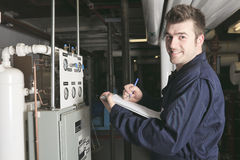 Maintenance engineer checking technical data of Stock Image