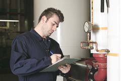 Maintenance engineer checking technical data of Royalty Free Stock Image