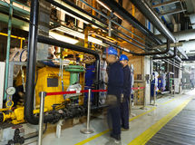 Maintenance engineers checking technical data of heating system equipment Royalty Free Stock Photography