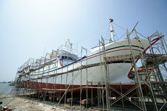 Maintenance of fishing boat. Stock Photography